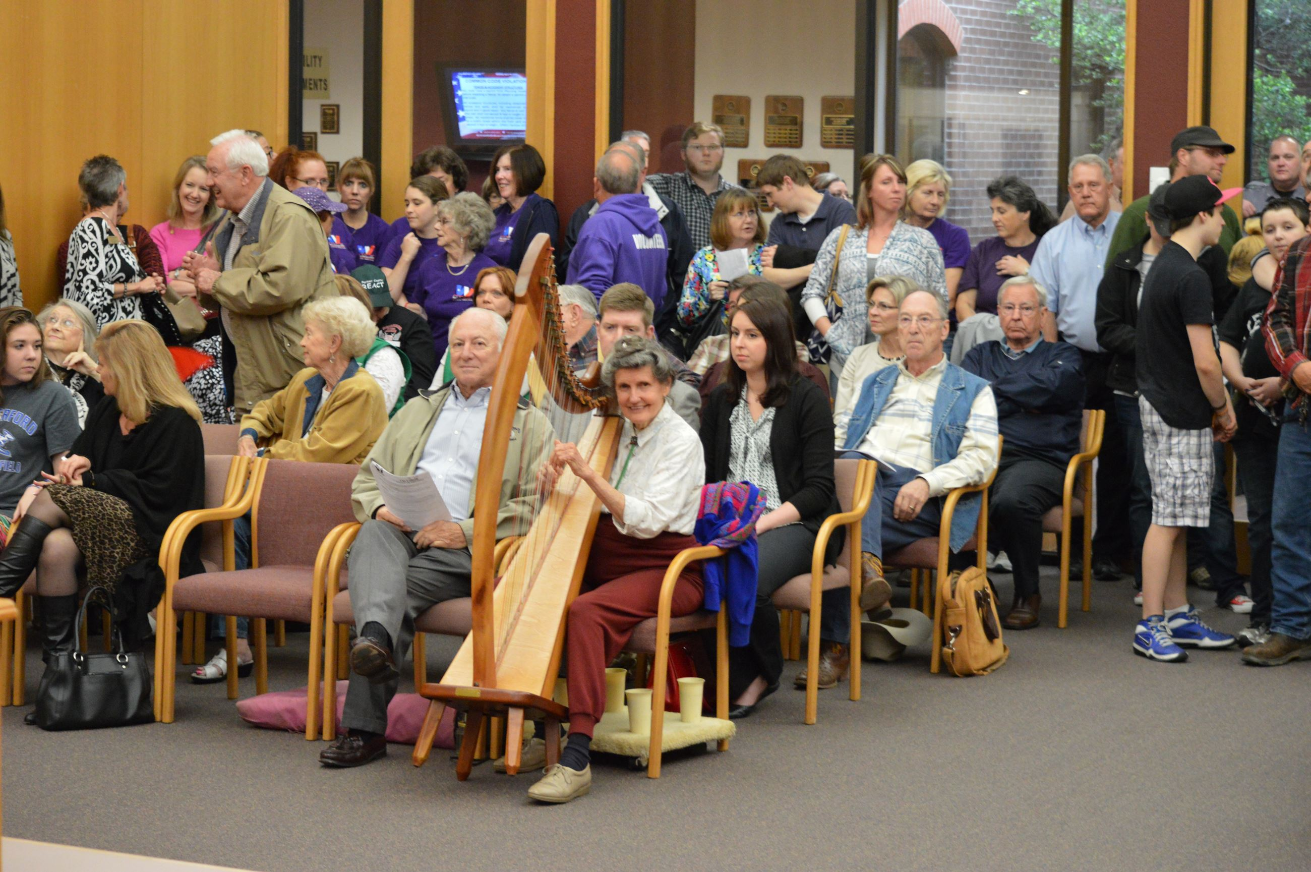 People at City Council Meeting